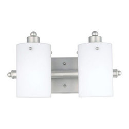 Quoizel Adano AN8539ES Bath Fixture - 14W in. - Empire Silver - Sometimes, a contemporary bath fixture with a distinctive presence can be tough to find, but you've found it with the Quoizel Adano AN8539ES Bath Fixture - 14W in. - Empire Silver. With strong lines and a bold aesthetic, this steel bath fixture is finished in a cool Empire silver color. The two etched opal glass shades soften and diffuse the light, and this fixture has quite the versatile design. You can install it facing downward or upward, whatever suits your space. The light requires two 100-watt medium base bulbs, not included. Sometimes, a contemporary bath fixture with a distinctive presence can be tough to find, but you've found it with the Quoizel Adano AN8539ES Bath Fixture - 14W in. - Empire Silver. With strong lines and a bold aesthetic, this steel bath fixture is finished in a cool Empire silver color. The two etched opal glass shades soften and diffuse the light, and this fixture has a quite versatile design. You can install it facing downward or upward, whatever suits your space. The light requires two 100-watt medium base bulbs, not included.About Quoizel LightingLocated in Charleston, South Carolina, Quoizel Lighting has been designing timeless lighting fixtures and home accessories since 1930. They offer a distinctive line of over 1,000 styles, including chandeliers, lamps, and hanging pendants. Quoizel Lighting is the perfect way to add an inviting atmosphere to any area in your home, both indoors and out.