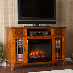 Southern Enterprises - Marcel Media Electric Fireplace - Features one open shelf, two drawers, and two window pane cabinets. Mission oak finish. Features 3 cord management openings, one per top shelf. Max weight capacity: 75lbs (mantel), 20lbs (each shelf). Accommodates up to a 50 in. flat panel TV. Constructed of China oak, MDF, PB, and ash veneer. Features realistic flickering flames and burning embers using long life LED lights. Remote control operated (1 CR2025 battery included). Easy to use controls for adjustable thermostat, with timer. Adjust flame and ember brightness separately for the perfect fire. Plugs into standard wall outlet with 6' cord. Tested to heat 1500 cubic feet in only 24 minutes (14 ft. x 14 ft. x 8 ft.). 120V-60Hz, 1500W / 5000 BTUs, 12.5 Amps. Safety thermal overload protector. No combustion - glass remains cool to the touch. 100% energy efficient and uses about as much energy as a coffee maker, offering low operating costs. Eco friendly - consumes no wood or fossil fuels and produces zero emissions or pollutants. Assembly required. 52 in. W x 18.25 in. D x 34.75 in. H. Shelf: 23.25 in. W x 17 in. D x 6 in. H. Drawers: 10 in. W x 14 in. D x 4 in. H. Cabinets: 10.5 in. W x 17 in. D x 22 in. H. Firebox front: 23 in. W x 20 in. HThis versatile media fireplace is as lovely as it is practical. The earthy, oak finish and mission design pair with multipurpose storage options in the ultimate media fireplace. To top it off, this fireplace requires no electrician or contractor for installation, allowing for instant remodeling without the usual mess or expenses. This mission fireplace features one open shelf for electronic components, two drawers for storing all the extras, and two window pane cabinets for movies, games, or any prized possession. The cabinet doors have a simple, mission design layered atop the glass; each cabinet features one fixed and one adjustable shelf to accommodate a variety of needs. The side panels of this media fireplace also feature mission panels for a well-rounded look. The electric fireplace insert requires no permanent wiring or ventilation - simply plug it into any wall outlet and enjoy the romance of a realistic fireplace. The electric insert features realistic flickering flames and glowing embers - brightness of each can be adjusted with a simple push of a button. In addition to adjusting the thermostat, the electric fireplace also offers the option of using with or without heat for year-round enjoyment. Convenience and ease of assembly are just two of the reasons why this fireplace is perfect for your home. The warm, mission style of this media fireplace works well in transitional to contemporary homes, as well as with lodge and Southwest decors. This contemporary fireplace is great for the living room and bedroom, and even adds a warm, romantic touch to the home office. Let this beautiful, functional fireplace give your home a more welcoming and enjoyable atmosphere.