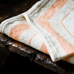 Arcadia Melon Blanket - Here's a great reason to spend a lazy evening on the couch — this blanket combines the breathability of linen and the softness of cotton. Use it as a throw, summer blanket, bedding accent, or throw it in on the grass on a summer afternoon.