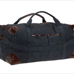 """Union Recycled Canvas Large Weekender Bag, Navy - With its distressed leather detailing and roomy interior, our weekender bag makes a stylish and ecologically friendly travel companion. 34"""" wide x 14"""" deep x 15"""" high Made of recycled canvas. Leather trim and brass hardware. Lined with cotton. Removable strap. Catalog / Internet only. Monogram will be centered on the top front."""