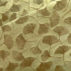 Maidenhair Upholstery Fabric in Mayflower - Maidenhair in Mayflower is a Ginkgo leaf pattern upholstery fabric made from a durable cotton blend. Available in a variety of metallic nature inspired hues, this fabric has a calming, zen-like element that grounds interior designs. Approved for upholstery use but light enough for structured draperies and other window treatments. American made from a blend of 63% polyester and 37% cotton with acrylic backing and a Teflon finish. This fabric passes Wyzenbeek 50,000 double rubs, Calif Bulletin #117, UFAC, ASTM E-84 adhered Class I and NFPA 260 Class I. Cleaning code: WS. This fabric meets or exceeds ACT standards for upholstery use. Repeat: approx 14.5″ v x 9″ h Width: 54″