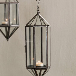 Pierre Atrium Hanging Lantern - Glamorously simple, the Pierre Atrium Hanging Lantern is a prism of glass framed in zinc-patina metal to create an updated take on the classic conservatory.� Fill with sprigs of greenery for a vivacious old-world European look or go fresh and edgy with single objets d'art � or put to a glowing purpose by adding a tealight or votive so the whole construction begins to softly glow.