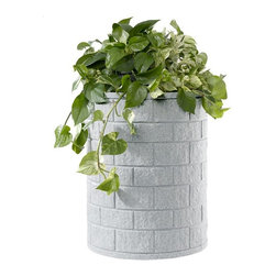 DMC - Self-Watering 25 Gallon Round Earth Planter - Large Brick - 95117 - Shop for Planters and Pottery from Hayneedle.com! About EarthPlanterOptimizing the balance between technology size design and functionality EarthPlanters are the result of ten years of research. These planter are successful because of a patent pending RapidWick watering system that delivers the nutrients your plants need automatically. RapidWick goes to work immediately and adjusts the water flow rate automatically as moisture demands change due to weather conditions. Each planter has a planting tray for soil-less mixture and this design promotes a deep even distribution of water to achieve great results. A large water reservoir lets you go anywhere between one week to two months between watering. Refill periods depend on size of planter (smaller need more frequent refills) and environmental conditions. An overflow assembly means your planter can never be overfilled. All the guesswork is taken out so there's no risk of under-or over-watering your plants and the proper amount of water air and nutrients are delivered to the root system at all times. Plants will thrive and daily maintenance is eliminated.