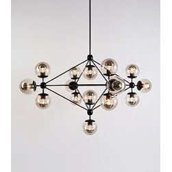 Modo Chandelier - 4 Sided - 15 Globe, Black - The design of Jason Miller's Modo Chandelier (2009) was inspired by off-the-shelf industrial parts like those found on Canal Street not too far from his Brooklyn studio. The Modo was first presented at the International Contemporary Furniture Fair (ICFF) in New York City in 2009. Bulbs (not included): incandescent 15 x 25W half silver globe/120V/E26 medium base. UL and CUL Listed. Made in U.S.A. All parts are customized through CNC milling made from solid aluminum. 4 sided. 15 smoked glass globes.