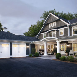 Coachman Collection - The white garage doors complement the white features on the beautiful home.