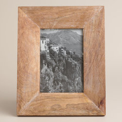 Natural Evan Wood Frame - I love the weathered look of these frames. I'd fill a handful of them with snapshots of faces and places my family and I love to make us smile, and warm up the space too.