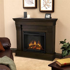 Real Flame - Chateau Electric Fireplace in Dark Walnut - 1400 Watt heater, rated over 4700 BTUs per hour. Programmable thermostat with display in Fahrenheit or Celsius. Ultra Bright LED technology with 5 brightness settings. Digital readout display with up to 9 hours timed shut off. Dynamic ember effect. Fireplace includes wooden mantel, firebox, screen, and remote control.. Solid wood and veneered MDF construction. 40.9 in. W x 11.8 in. D x 37.6 in. H (78.6 lbs.)The Chateau Fireplace features the clean lines and classic styling familiar to stone mantels, realized in wood. In three great finishes, this design is sure to compliment a variety of decor, from the classic to contemporary. The Vivid Flame Electric Firebox plugs into any standard outlet for convenient set up. Thermostat, timer function, brightness settings and ultra bright Vivid Flame LED technology.