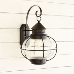 Charleston 1-Light Outdoor Lantern - I've wanted to switch out my run-of-the-mill sconce with this beautifully crafted outdoor lantern for some time now. I especially love its seeded glass and vintage caging.