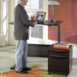Jesper - Jesper Sit and Stand Height Adjustable Desk - Espresso Dark Brown - 7190105-ES - Shop for Desks from Hayneedle.com! When 3:30 rolls around on a workday and you're feeling stiff don't worry - you aren't aging more quickly than you think you are. You're really just feeling the effects of sitting in one place a little too long - pressure on the discs in your back is increased 40 percent by sitting rather standing. That's why the Sit and Stand Height Adjustable Desk - Espresso is designed to work for your body as you're working through the day. Motorized legs lift the desktop from a seated height to a standing height any time you feel the need to limber up. This sleek and stylish computer desk is crafted from durable wood veneers and engineered wood with solid wood edging - as well as a recessed perforated wood modesty panel - finished in a rich modern espresso (almost black) shade. The spacious desktop is ergonomically curved to provide the best arm support while you're working at a computer or laptop. Below motorized steel legs finished in an Anthracite black move from 25H inches to 52H inches with a quick push of a button. Alternating between sitting and standing positions while working can reduce the discomfort and possible injuries caused by staying in a stationary position for long periods of time. Available Sizes: 47W x 36D x 25-52H inches 63W x 39D x 25-52H inches 75W x 41D x 25-52H inches