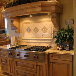 Rustic Luxury - Combination of rustic wood, tumbled ceramics and solid granite proved succcessful.