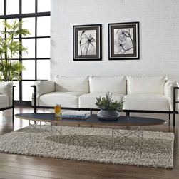 Surfboard Coffee Table in Black (EEI-302-BLK) - The effects of buoyancy are carefully observed in this energetic piece. Although the polished steel rod stands are a work unto their own, the simple beauty of this table is in its completeness. While the top extends the length of a standard sofa, the tone is both slight and charming. Rather than something massive, the elliptical nature of the plywood top seems to effortlessly ride the horizon line. Surfboard is a favorite among commercial reception and lounge areas, that seek something both formative and conceptually unobtrusive. Set Includes: One - Surfboard Elongated Coffee Table