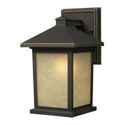 One Light Oil Rubbed Bronze Tinted Seedy Glass Wall Lantern - The solid, timeless styling of this small outdoor wall mount makes this a versatile fixture, suiting both traditional and modern styles.  Warm tinted seedy glass panels are paired with a finish of oil rubbed bronze, to create a very inviting look. Made of cast aluminum, this fixture is made to endure nature, regardless of the season