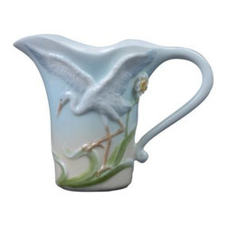 US - 4.75 Inch Glazed Porcelain Egret Creamer with Yellow Flowers - This gorgeous 4.75 Inch Glazed Porcelain Egret Creamer with Yellow Flowers has the finest details and highest quality you will find anywhere! 4.75 Inch Glazed Porcelain Egret Creamer with Yellow Flowers is truly remarkable.