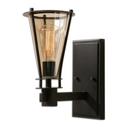 Uttermost - Frisco 1-Light Rustic Wall Sconce - Thomas Edison did not envision this when he invented the lightbulb. The cognac-tinted glass is only matched by the rustic black metal details that hold this prism of light. In your entryway, it will welcome all visitors. In your hallway, you'll want that warm glow thrown off by the antique style bulb, which is included.