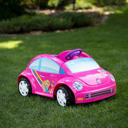 Fisher-Price Inc - Fisher-Price Power Wheels Barbie VW Beetle Battery Powered Riding Toy Multicolor - Shop for Tricycles and Riding Toys from Hayneedle.com! Your little go-getter will be on the go go go when she's cruising around on the Fisher-Price Barbie Battery Powered VW Beetle W6209. Styled just like the new Volkswagen Beetle with Barbie's signature touches this ride-on moves at speeds up to 2.5 MPH and has a 50 lb. weight capacity. It moves forward and backward on hard surface and is easily powered by a foot pedal. She'll love how the driver's door opens and closes and you'll love that the rechargeable 6-volt batter and charger are included. About Fisher-PriceAs the most trusted name in quality toys Fisher-Price has been helping to make childhood special for generations of kids. While they're still loved for their classics their employees' talent energy and ideas have helped them keep pace with the interests and needs of today's families. Now they add innovative learning toys toys based on popular preschool characters award-winning baby gear and numerous licensed children's products to the list of Fisher-Price favorites.