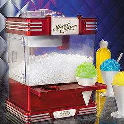 Nostalgia Products - Retro Snow Cone Machine - Includes two reusable plastic cones. Convenient countertop model. Works with standard ice cubs. Side tray to hold cones. Wattage: 35 watts. Stainless shaving blade. Warranty: 90 daysThe Snow Cone Machine helps create refreshing snow cones at home anytime! Use ice cubes to make shaved ice then add your choice of flavored syrup and enjoy a cold, tasty treat that's fun for the whole family and a great relief from the summer sun. You can even make fruit slush drinks, yogurt snow and smoothies! Designed for kitchen use, the snow cone machine can also be used in a number of other locations such as dorm rooms, offices, club houses and family or rec rooms. Now you can enjoy the wonderful cool taste of Snow Cones anytime in the convenience of your own home.