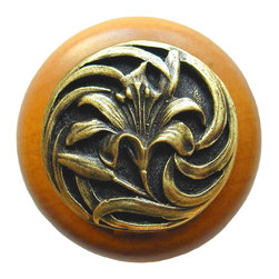 """Inviting Home - Tiger-Lily Maple Wood Knob (antique brass) - Tiger-Lily Maple Wood Knob with hand-cast antique brass insert; 1-1/2"""" diameter Product Specification: Made in the USA. Fine-art foundry hand-pours and hand finished hardware knobs and pulls using Old World methods. Lifetime guaranteed against flaws in craftsmanship. Exceptional clarity of details and depth of relief. All knobs and pulls are hand cast from solid fine pewter or solid bronze. The term antique refers to special methods of treating metal so there is contrast between relief and recessed areas. Knobs and Pulls are lacquered to protect the finish. Alternate finishes are available. Detailed Description: A very detailed and beautiful knobs are the Tiger Lily knobs. They are very delicate and bears a lot of positive history. The Tiger Lily is an orange flower that is covered in spots. It has been a useful medical remedy for many centuries. Its scent is said to suppress aggressive behavior and promotes overall good feeling. The smell is said as a superstition to give whoever smells it freckles."""
