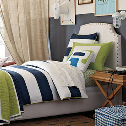 Ronan Duvet - Ronan's crisp color combination recalls days by the sea and boats on the lake. Beachy navy/white rugby stripe with lime piping and button closures.
