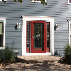 Gray James Hardie Siding with Red Door Entry - James Hardie Fiber Cement Siding: Evening Blue | HardieTrim: Arctic White - Opal Enterprises