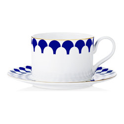 B by Brandie - Zelda Bone China Cup & Saucer- Navy (Set of 4) - Nothing short of bold, mesmerizing color would seem sufficient, so this dramatic set follows suit with a navy blue and white kaleidoscope pattern and decadent gold trim. Pile on the pattern if you dare, or offset with simple solid pieces. Either way, wallflowers need not apply.