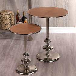 Leather Top Aluminum Table - A beautifully polished, reflective base creates a sleek, composed contrast with the leather top of this aluminum table that has a bit of art deco appeal. Made with simple circular forms, this accent table is offered in two sizes that work well with a ton of styles from boho to transitional. Perch one wherever you need a spot to hold a drink or book.