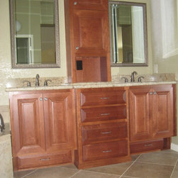Limbach - Custom built Master vanity cabinets with center tower and toe kick drawers