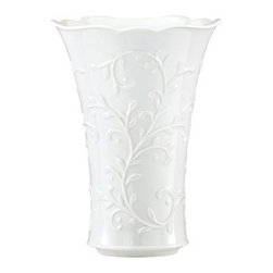 Lenox 9H in. Opal Inn Carved Vase - Give the gift of elegance with the Lenox 9H in. Opal Inn Carved Vase. Okay, the gift may be to yourself, but you deserve it, right? Crafted of porcelain and finished in a clean, beautiful white, this vase features a scalloped rim and raised vine motif. It's all in the details, and this one has them in the bag.About Lenox CorporationLenox Corporation is an industry leader in premium tabletops, giftware, and collectibles. The company markets its products under the Lenox, Dansk, and Gorham brands, propelled by a shared commitment to quality and design that makes the brands among the best known and respected in the industry. Collectively, the three brands share 340 years of tabletop and giftware expertise.