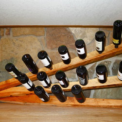Custom Mantelpiece Wine Rack - This project did not allow for much vertical space so the design adapted into more of a horizontal wine rack. Holds twenty one bottles. Contact me via email to start the design process for your own unique wine rack.