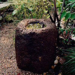 Antique Belong - Passed through the generations, these stone vessels were used in Indonesia to hold water and food for families. The age of each piece ranges from 75 to 200 years and possibly more. The antique belong is a natural addition to any garden and is internationally a sought after collectors piece. Each reclaimed piece is unique in its character with differing shape, size and type of stone