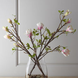 "John-Richard Collection - John-Richard Collection Japanese Magnolia Faux Floral Arrangement - Exclusively ours. Slightly exotic and very alluring, this simple arrangement features Japanese magnolia stems artfully displayed in a clear glass vase with black river rocks and acrylic ""water."" It's the perfect choice when you want light and airy wit..."