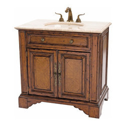 Ambella Home - Bayne Sink Chest - Crafted from gmelina and finished in a warm honey, this sink chest features two doors, slight distressing and an antique travertine stone top. Balsa porcelain sink installed. Dimensions: 36 in. x 22 in. x 36 in.