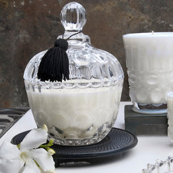 French Lavender Sugar Boudoir Candle - 10 oz. - Wisps of fresh lavender dancing in a summer's breeze let loose a soothing scent to the skies; the French Lavender Sugar Boudoir Candle bestows the same heavenly fragrance to your home. The beautifully stylized glass vessel with scallop detail adds a touch of Parisian prettiness to your boudoir or en suite, while the soy-based candle imparts clean and natural burning.