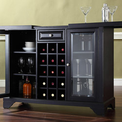Crosley Furniture - Bar Cabinet in Black Finish - Sliding expandable top. Beveled or tempered glass doors. Raised front panel drawer. Adjustable shelves and plentiful storage space for spirits, appliances and other items. Center storage area is great for up to fifteen bottles of wine. Can be remove wine storage cubes to reveal an adjustable shelf. Brushed nickel hardware. Doubles as a serving station when entertaining. Adjustable levelers in legs. ISTA 3A certified. Warranty: 90 days. Made from solid hardwood and wood veneers. Assembly required. Min: 47.75 in. W x 20 in. D x 36 in. H (220 lbs.). Max: 64 in. W x 20 in. D x 36 in. H (220 lbs.)Elegantly entertain guests with this sliding top bar cabinet Style, function and quality make this sliding top bar cabinet a wise addition to your home.