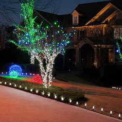 Unique Outdoor Holiday Decorations - LED mini lights decorate this residential outdoor space as tree lights and light balls, which are lights wrapped around a ball of chicken wire. LED mini lights come in colors of red, green, blue, amber orange, gold, warm white, cool white, pink, and multi-color. For directions on making the LED light balls, visit: blog.christmaslightsetc.com/diy/how-to-make-christmas-light-balls/