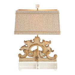 Wakefield Painted Hand Carved Solid Wood Fragment / Acrylic Lamp - Bestow a refined embellishment to your transitional decor with the Wakefield Painted Hand Carved Solid Wood Fragment/Acrylic Lamp. Inspired by the gentility of English fittings, the lamp is a vision in adornment without the need for excessive ornamentation. The Gold Silk Twist Trim Accent on the Natural Linen Shade hints at the daintily applied gold tones that accentuate the gentle curves of the base.