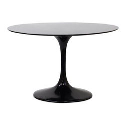 """Lippa 48"""" Fiberglass Dining Table - Reflecting a seamless organic shape and timeless form, the Lippa Table has become a symbol of modernism for over the past 60 years. Before its release, homes were filled with clunky remnants of an industrial age long gone by. But in order to advance into the new world, homes first had to transition from the traditional square table, into a piece that connoted progress. The base and dimensions are true to the original specifications, while the tables circular top, and tapered base, are carefully lacquered with a scratch and chip resistant finish."""