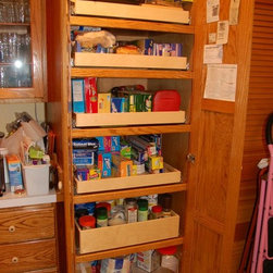 Mary Lee A's Jeffersontown, KY Installation - Organize your kitchen with the help of an efficient pantry full of custom pull out shelves from ShelfGenie of Kentucky.  Each shelf holds up to 100 pounds, even when the shelf is fully extended.