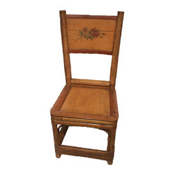 Consigned: Rattan Child's Chair - This rattan child's chair has hand painted flowers on the back panel. It is in good condition with a crack in the back panel.