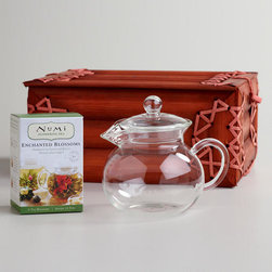 Numi Flowering Tea Gift Set - This Numi flowering tea set is a beautiful gift option. The bamboo box becomes a keepsake, and the clear teapot becomes part of a visual display. Plus, you can watch the tea buds blossom as they hit the hot water. What a nice way to end the day!