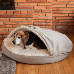 """Snoozer - Snoozer Cozy Dog Cave - 87000 - Shop for Beds Covers and Fill from Hayneedle.com! The Snoozer Pets Cozy Cave has a sheepskin pocket designed so that all small pets can snuggle with the comfort of a sheepskin cover on top of them as well as underneath. A cover support keeps the top cover in place so it can be easily entered. The Cozy Cave comes in three sizes: 25-inch 35-inch and 45-inch diameter. This little pet cave features a poly/cotton fabric on the exterior top bottom and side wall and a faux lambswool top and interior cover. There are handsome sturdy brass zippers on the exterior cover and the filling is composed of fine-spun polyester and cedar. The Cozy Caves cover is washable and due to its polycotton composition will maintain its color and fresh-looking appearance for years to come. Snoozer Pets Cozy Cave Dimensions: Small: 25L x 25W x 12H inches Hood Height: 4 in. Large: 35L x 35W x 13H inches Hood Height: 4 in. Extra Large: 45L x 45W x 14H inches Hood Height: 4 in. About SnoozerNorman O'Donnell wanted something better for his dogs but found that pet shops didn't sell such products. So in 1985 he established O'Donnell Industries to manufacture Snoozer Pet Products. Today O'Donnell offers customers a profusion of quality pet products. Because today's pets are considered """"part of the family """" Snoozer Pet Products are designed to blend easily with almost any home decor. The company's indoor products are crafted from upholstery-grade fabrics available in a multitude of colors and patterns that will keep your animals stylishly warm and comfy."""