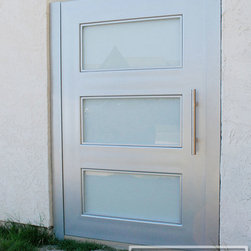 Modern Style Courtyard Gate in Steel & Opaque Glass Panes | Manufactured in OC! - Dress up your courtyard passage way with a custom made modern gate by Dynamic Garage Door of Orange County. We custom design and handcraft each one of our client's gates.