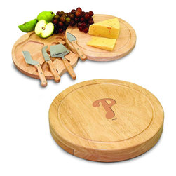 """Picnic Time - Philadelphia Phillies Circo Cheese Board in Natural - The Circo by Picnic Time is so compact and convenient, you'll wonder how you ever got by without it! This 10.2"""" (diameter) x 1.6"""" circular chopping board is made of eco-friendly rubberwood, a hardwood known for its rich grain and durability. The board swivels open to reveal four stainless steel cheese tools with rubberwood handles. The tools include: 1 cheese cleaver (for crumbly cheeses), 1 cheese plane (for semi-hard to hard cheese slices), 1 fork-tipped cheese knife, and 1 hard cheese knife/spreader. The board has over 82 square inches of cutting surface and features recessed moat along the board's edge to catch cheese brine or juice from cut fruit. The Circo makes a thoughtful gift for any cheese connoisseur!; Decoration: Laser Engraved; Includes: 1 cheese cleaver (for crumbly cheeses), 1 cheese plane (for semi-hard to hard cheese slices), 1 fork-tipped cheese knife, and 1 hard cheese knife/spreader"""