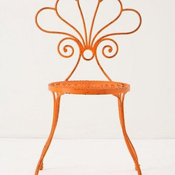 """Le Versha Chair, Orange - This colorful wrought iron chair just says """"garden party.""""  I think it would also look just right around an old wood table in a breakfast nook."""