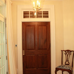 Interior Doors - Stained Rustic Walnut door with painted transom, frame & trim.