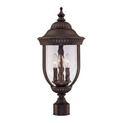 Savoy House - Castlemain Post Lantern - An incredibly versatile and economical group with clear watered glass, available in a variety of sizes, plus post and hanging. Also available in Energy Star with Tuscan glass. Walnut Patina finish and Clear Hammered Glass.