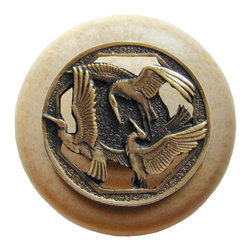 "Notting Hill - Notting Hill Crane Dance/Natural Wood Knob - Antique Brass - Notting Hill Decorative Hardware creates distinctive, high-end decorative cabinet hardware. Our cabinet knobs and handles are hand-cast of solid fine pewter and bronze with a variety of finishes. Notting Hill's decorative kitchen hardware features classic designs with exceptional detail and craftsmanship. Our collections offer decorative knobs, pulls, bin pulls, hinge plates, cabinet backplates, and appliance pulls. Dimensions: 1-1/2"" diameter"