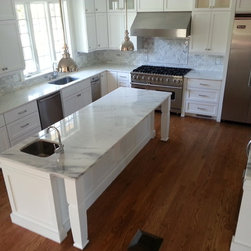 White Marble Kitchen - Imperial Damby Polished Marble Countertops with Straight Polished Edges.