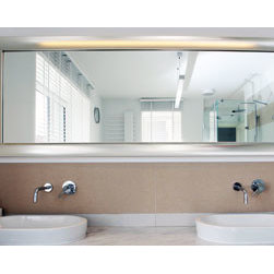 Silver framed on bathroom mirror - The frame's profile has a oval hammered top. The finish is bright chrome.
