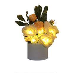 The Firefly Garden - Radiant Roses - Illuminated Floral Design, White and Yellow, White Ceramic Vase - Bring the timeless beauty of Roses to your home, with the added feature of lighting. Housed in a selection of vases, Radiant Roses is perfect for a guest bedroom or bathroom. This battery operated floral arrangement is a unique alternative to a night light .The glowing Roses cast subtle and beautiful shadows to accent any space.