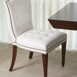 Atlanta Chair - White - Pure white, tufted leather looks classic, upscale, and slightly indulgent on an upholstered side chair design which suggests the gracious living and lush luxury embodied in the manorial breakfast room.  Paired with sheer lace curtains, the Atlanta Chair looks romantic yet defined � yet the combination of saber legs and spade feet also beautifully suits a room with a more eclectic outlook on the past.
